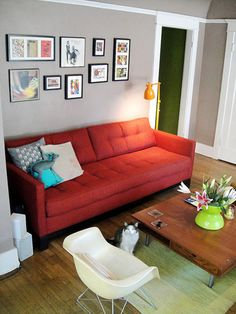 red couch grey walls