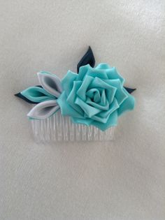 Luxury Satin Mint Green Rose fixed onto a clear comb for easy wear. Can be worn as a lapel flower fixed onto a clear pin.