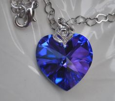 WANT BADLY-Blue Heart Necklace, a deep blue swarovski heart with elegant zirconia in a heart chain. $24.99, via Etsy.