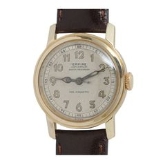 Empire Yellow Gold Wristwatch with Sweep Center Seconds circa 1950s   From a unique collection of vintage wrist watches at https://www.1stdibs.com/jewelry/watches/wrist-watches/