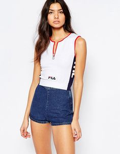 Fitted Crop Top With Zip Front Detail by Fila. Top by Fila, Stretch jersey, Round neckline, Zip front, Cropped length, Regular fit - true to size, Machine wash, 95%...