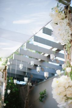 Lovely to have hanging candles in a chuppah built with branches and flowers