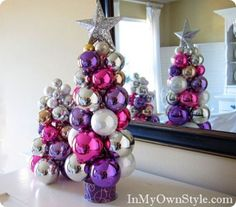 Made with a ribbon spool and knitting needle! Ornaments just slide on. Pretty and easy.