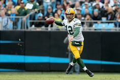 Aaron Rodgers #12 of the Green Bay Packers scrambles out of the pocket against the Carolina Panthers in the 1st quarter during their game at Bank of America Stadium on November 8, 2015 in Charlotte, North Carolina. (Nov. 7, 2015 - Source: Streeter Lecka/Getty Images North America)