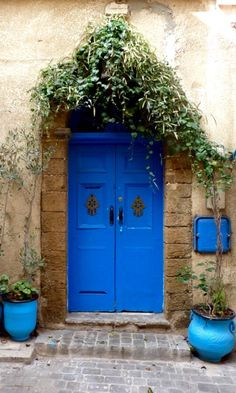 Love the blue door & how it accents the rustic feel of the exterior of this house!