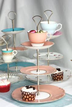 everyone is making there own cake stands I love these one that have a cup incorparated