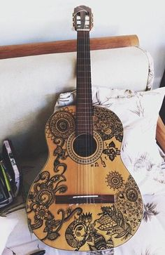 Beautiful Spanish acoustic with henna etchings on it