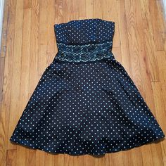 Windsor Dress*SALE* Short, strapless black dress with turquoise polka dots and lace center. It has built in wires/corset at the top of the dress. Gently used. Only wore it once to a wedding. 100% polyester. WINDSOR Dresses Strapless
