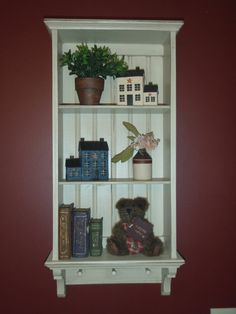 Handcrafted primitive wall shelf.