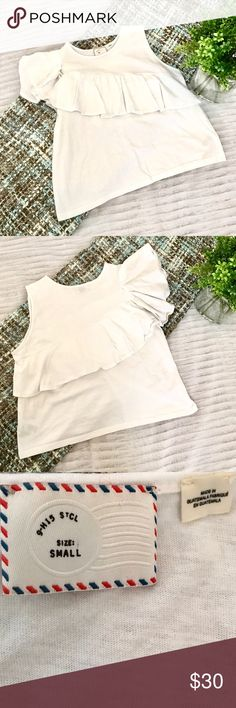 Anthropologie White Ruffle Top Beautiful top from the brand Postmark. One sleeve has a ruffle detailing. Slightly cropped. Size Small. Measurements: 18 in pit to pit, 18 in shoulder to hem. No modeling and no trades. Anthropologie Tops
