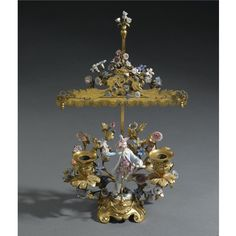 A Meissen porcelain-mounted gilt-bronze candelabrum, the porcelain circa 1750, the mounts Louis XV/XVI, Transitional, circa 1765.