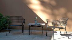 EMU Kira Table and EMU Lyze Lounge Chairs in an office courtyard.