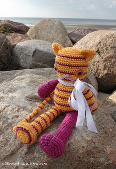Sun the Stripy Cat by CuddlyandSoft on Etsy or in blog www.ilunikerdused.blogspot.com  This little kitty-cat is bright and sparkly like the Sun, that is how it got its name. The cat can be put either in a sitting or standing position. This joyful kitty is made of Egyptian cotton yarn and stuffed with sheep's fleece. The toy is decorated with a luscious satin ribbon that can be removed. I used child friendly safety toy eyes, which are impossible to remove with bare hands.