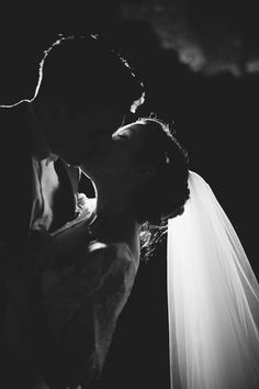 "Gorgeous silhouette shot of the bride and groom kissing. Much more impactful and artistic than the traditional ""you may kiss the bride"" shots."