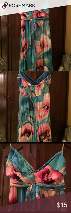 Colorful Maxi Floral printed and strapless long maxi dress....material has a crinkled look and is elastic along the top. Super comfortable and cool!! Xhilaration Dresses Maxi