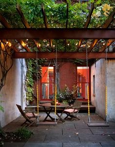 Kim Hoyt Architect, Remodelista. Carroll Gardens, Brooklyn garden. Wisteria and grape leaves add privacy to a brownstone back yard.