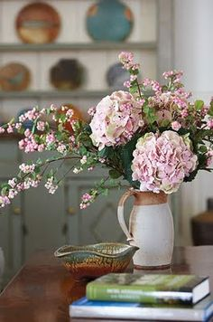 Casual pink floral arrangement in a pitcher, is the perfect pop on an entry or coffee table, or kitchen table.
