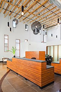 Reception Desk, and work office space divided by partition more than a full wall. cool ceiling!