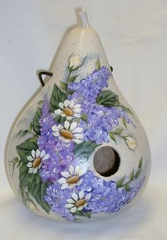 This birdhouse is a martin house gourd 11 tall and 24 around. It is based in off white with lilacs white daisies. Can be used inside or outside in Decorative Gourds, Hand Painted Gourds, Decorative Bird Houses, Clay Pot Crafts, Crafts To Make, Gourd Crafts, Wood Burning Patterns, Wood Burning Art, Gourds Birdhouse