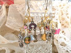small charm earrings assemblage random found by lilyofthevally