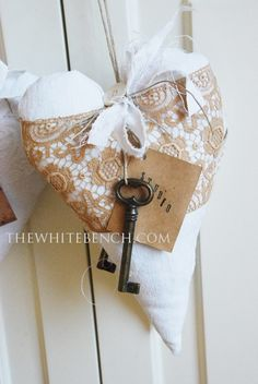 Shabby Chic Fabric Heart...wrapped in lace...with old skeleton keys...The White Bench.