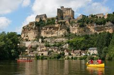 Photo about Tourists kayaking on river Dordogne with Château de Beynac in the background as seen in Beynac-et-Cazenac, Southern France. Image of french, beynac, beautiful - 30492525 Aix En Provence, Best Vacation Destinations, Best Vacations, The Tourist, Bordeaux, Beynac Et Cazenac, Santa Cruz Camping, La Dordogne, Perms