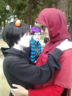 ((This is a cute DaveKat cosplay but then THERE'S ERIDAN AND HIS FACE IN THE BACKGROUND.))