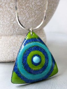 Triangle Target Enamel Pendant Necklace: Lime Green and Robin's Egg Blue Kiln-fired Glass Enamel on Copper, Sterling Silver Snake Chain. $88.00, via Etsy.