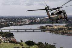 An Australian Army Blackhawk helicopter belonging to the 6th Aviation Regiment tours over Perth with media onboard, ahead of the regiments training in the area over the coming weeks. WAN-0000371 © WestPix 05/05/2014 Pic Simon Santi/The West Australian