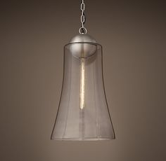 """RH's Collins Pendant:With a subtly flared glass shade suspended from an industrial-style metal sphere, our pendant's silhouette showcases the warmth of an Edison-style filament bulb. 8"""" dia x 14"""" H"""