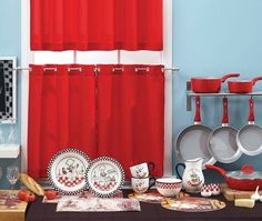 Afraid of using color in your home? Don't be…for color inspiration, look to patterns in your dinnerware and pull something bold to make a statement. We pulled the red from our Little Chef Dinner Collection, and added window tiers and cookware to match. The red accents are a bold compliment to the soft blue wall color. #AnnasLinens
