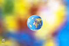A small world it is... - High speed water drop refraction Photography.