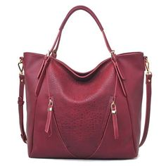 """A stylish two handle handbag/tote with faux Croc center front panel and outside zipper pockets on both sides. It comes with a detachable shoulder strap. 19""""L x 5""""W x 15.5""""H 100% Vegan Leather"""