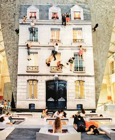 Bâtiment by Leandro Erlich.  Interactive art installation,consists of horizontal building facade and a large mirror,that allows people to take creative photos.Now on display at Le Centquatre, Paris.