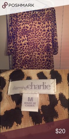 Cheetah Print Dress Super cute 3/4 length sleeve cheetah print dress!!!! Love this dress, but it's time to make room for some new clothes!!!! Charming Charlie Dresses Midi