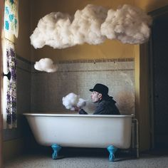 Liking photographer Logan Zillmer's surreal 365 Project with cloud puffing, bowler hatted men http://www.mymodernmet.com/profiles/blogs/logan-zillmer-365-project