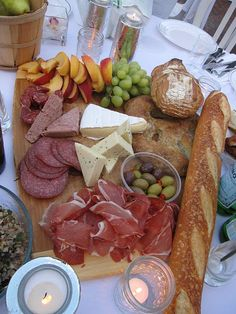 Easy Cheese + Meat Board 1) Serving Platter - cutting board or rustic looking serving platter 2) Meats -proscuitto, spicy salami, dry cured sausages 3) Pate - Cut into two generous triangle chunks 4) Bread - Baguettes, country loaf. Crackers work too 5) Olives - variety 6) Cheese -brie, havarti, gouda 7) Fruit -grapes, peaches, figs, strawberries, green apple slices, dried apricots are great too 8) Nuts -natural unsalted almonds, walnuts and pecans 9) Spreads - Fig compote or honey for…