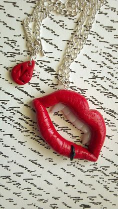 Polymer clay pierced vampire lip necklaces. $13.99, via Etsy.