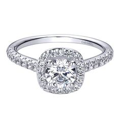 14kt white gold semi-mounting engagement ring, halo style. Containing 0.39ctw of round brilliant cut diamonds, SI1 clarity, G-H color, shared prong set. The rin