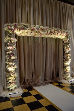 Floral arch of white hydrangea, blush garden roses.