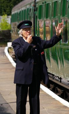A volunteer guard at Kingscote station on the Bluebell Railway.