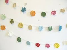 SUCH a cute idea for garland! You could choose any color combo, and practice your crochet stitches at the same time!