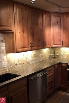 Knotty Alder Cabinets | Natural Stain Kitchen Cabinets, Dark Hardwood Flooring, Light Brown Granite Countertops #kitchen