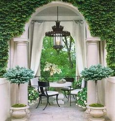 this is gorgeous and the chandelier a focal point drawing your eye to the beautiful arch and green landscape beyond
