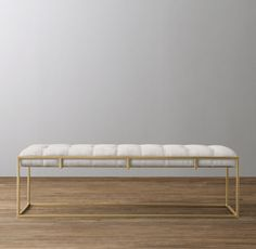RH Baby & Child's Kellen Upholstered Wide Bench - Antiqued Brass:Our bench's crisp right angles and unadorned finish recall the sleek design of mid-century architecture, while its hand-tufted cushion – nestled securely within the sturdy iron frame – gives a nod to the enduring comfort of the classic Chesterfield sofa.