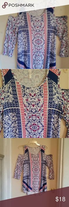 Cold Should Symmetrical Top Super cute peasant print cold shoulder symmetrical hi low top.    3/4 length sleeves. Navy  Blue,  Red & White.  Viscose/Spandex.  Perfect with leggings or skinny jeans. NWOT Passport Tops Tunics
