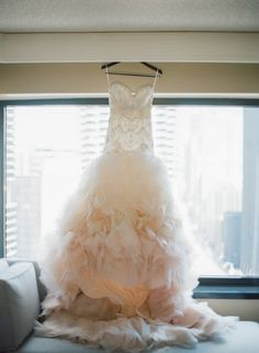 Photography : Britta Marie Photography Read More on SMP: http://www.stylemepretty.com/2016/01/22/elegant-chicago-wedding-with-an-amazing-donut-wall/