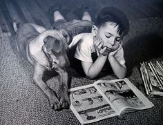 Boy & his dog just reading comics