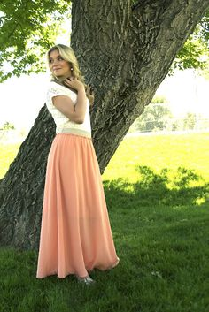Coral Maxi skirt, lace tee, and chunky necklace.