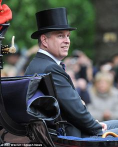 Prince Andrew was pictured riding in a third Barouche
